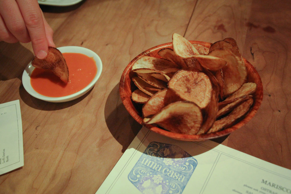 Homemade potato chips and salsa