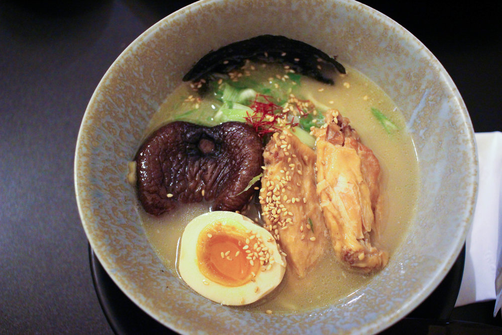 Tori Paitan (Chicken Ramen) with rich chicken and dashi broth & whole wheat noodles. Toppings: braised wing, shitake mushroom,dried seaweed, softcooked marinadeegg, dried seaweed & green onion.