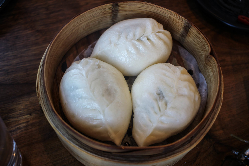 Steamed chicken bao with green onion, mushroom, and ginger