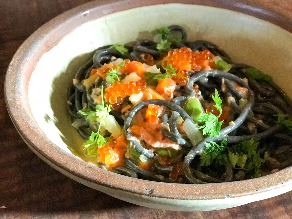 Squid ink bucatini with smoked salmon and fava beans