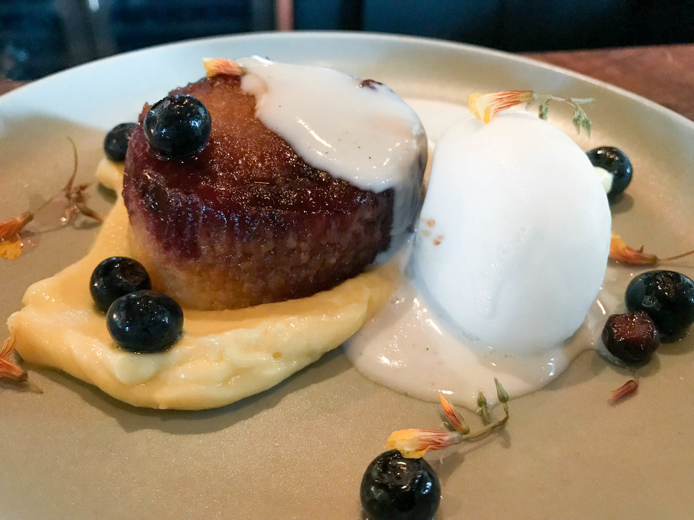 Warm polenta cake with coconut crema, lemon curd, and blueberry.
