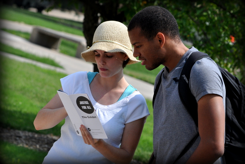 Above, 2013-2014 Intern Holly Meath interacts with a student during campus outreach.
