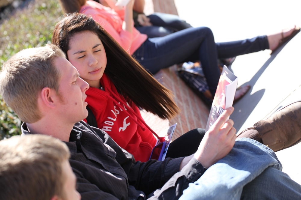 Steve Wagner shares a JFA brochure with a student at the University of Arizona in 2012.