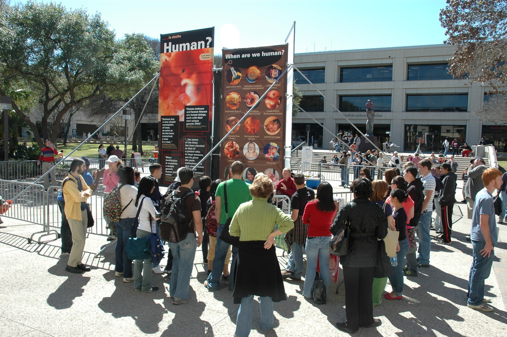 At the University of Texas at San Antonio in 2009, JFA trainer Jon Wagner (maroon shirt, center) interacts with a crowd of students.