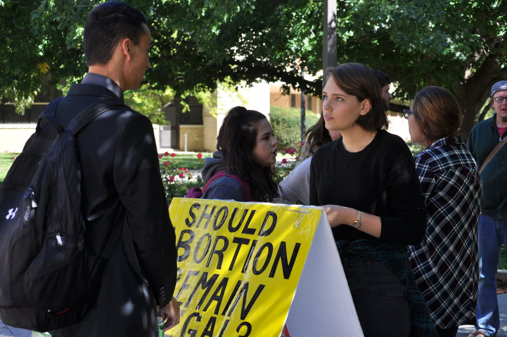 Grace Fontenot interacts with a student at Fort Hays State University in Hays, Kansas, in September 2016.  Grace is raising support to work full-time with Justice For All.