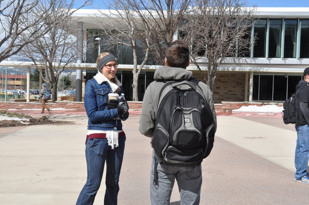 Moriah interacts with a Colorado State University student during a JFA outreach event in April 2016.