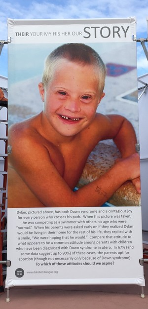 "JFA's  ""Stop and Think"" Exhibit  features this panel, prompting discussion about what our attitudes should be towards those, like Dylan (shown above), with Down syndrome."