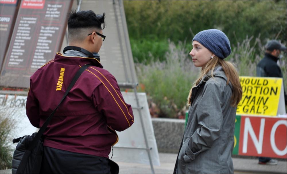 JFA Intern Susanna Buckley (right), at JFA's University of Minnesota (UMN) outreach in October.