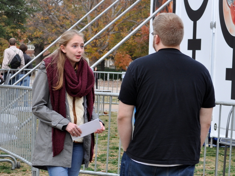 Susanna Buckley (left), talks with a student at JFA's University of Oklahoma (OU) outreach in November 2017.