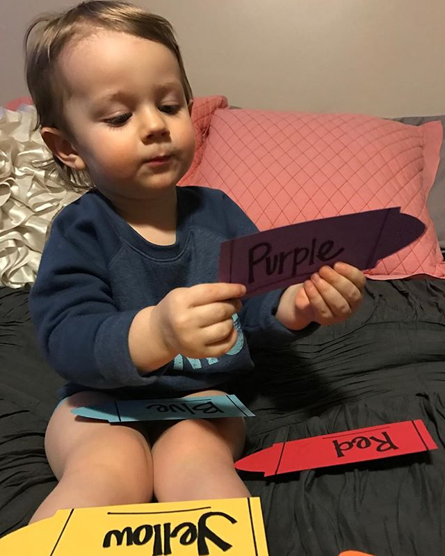 This little boy is learning his colors, and this crayon activity we featured with The Day the Crayons Quit is perfect!  #cutekidsreadingbooks #learningcolors #crayonactivity #kidsactivities #raisingreaders #thedaythecrayonsquit
