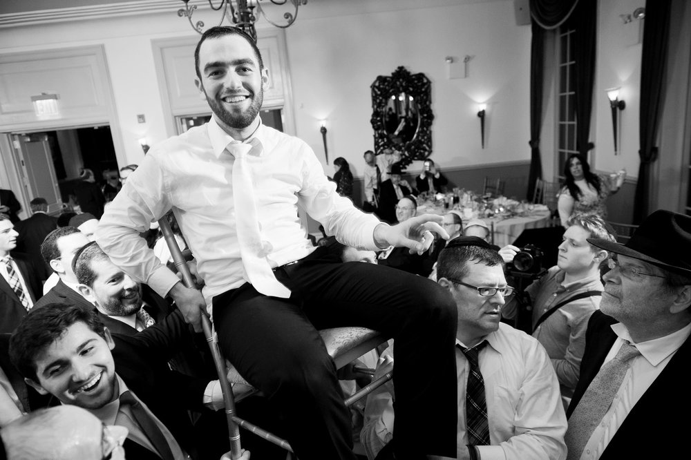 Orthodox Jewish Wedding, Dyker Beach Park and Golf Course, Brooklyn, New York, Photo by Chaim Schvarcz, Dancing, On chairs, Groom