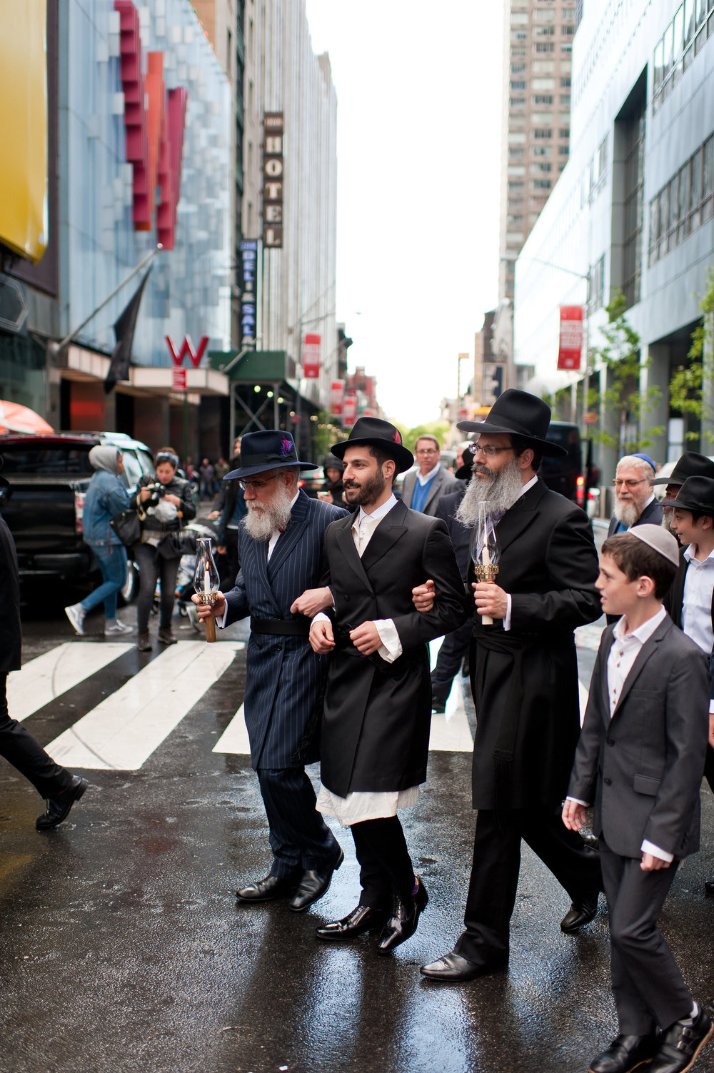 Historic Chabad Orthodox Jewish Wedding in Times Square Manhattan New York NYC Photo by Chaim Schvarcz, groom, father of the groom, father of the bride, walking down the isle