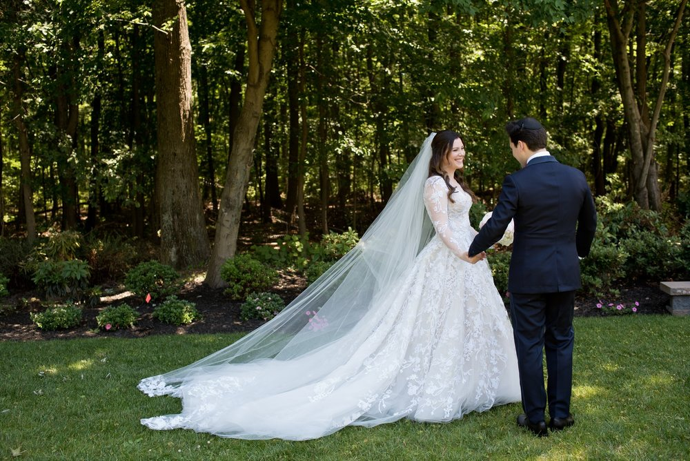 Abby and Miles' Modern Jewish Wedding at Nicotra's Ballroom, Hilton Garden Inn, Staten Island, NY, Photos by Chaim Schvarcz bride groom first look