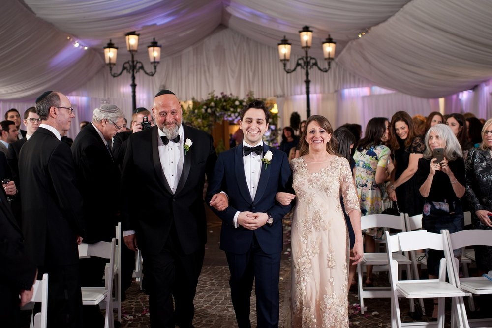 Abby and Miles' Modern Jewish Wedding at Nicotra's Ballroom, Hilton Garden Inn, Staten Island, NY, Photos by Chaim Schvarcz groom walking down isle