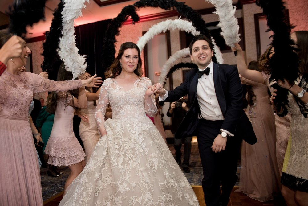 Abby and Miles' Modern Jewish Wedding at Nicotra's Ballroom, Hilton Garden Inn, Staten Island, NY, Photos by Chaim Schvarcz dancing bride groom