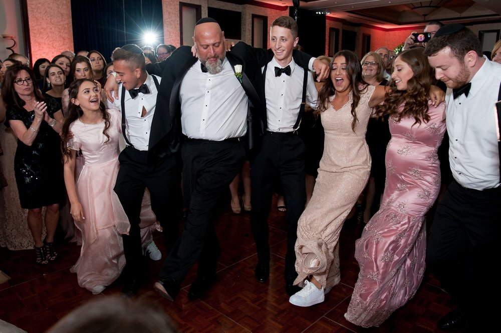 Abby and Miles' Modern Jewish Wedding at Nicotra's Ballroom, Hilton Garden Inn, Staten Island, NY, Photos by Chaim Schvarcz dancing