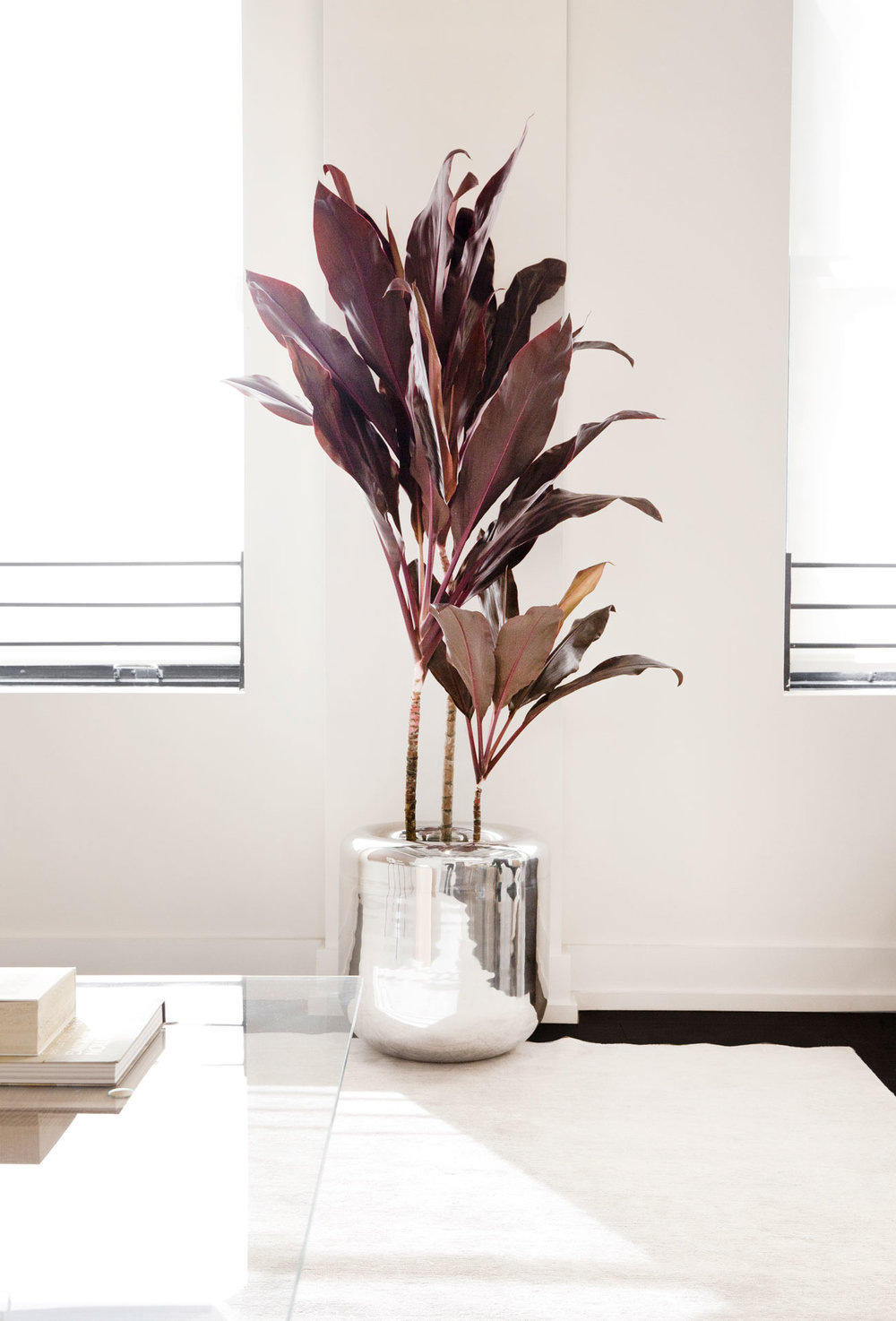 High-polished  Rounded Metal Planters  by Early Work can be found throughout the space.  More info