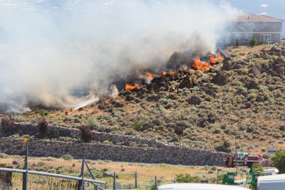 A small brushfire threatening homes near Parr Blvd and 395.