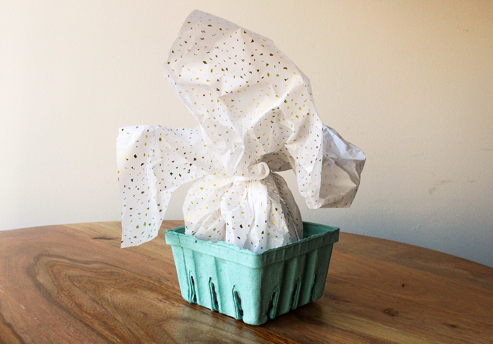 Simply Gifted:   Gift wrapping idea using paper berry baskets and tissue paper.