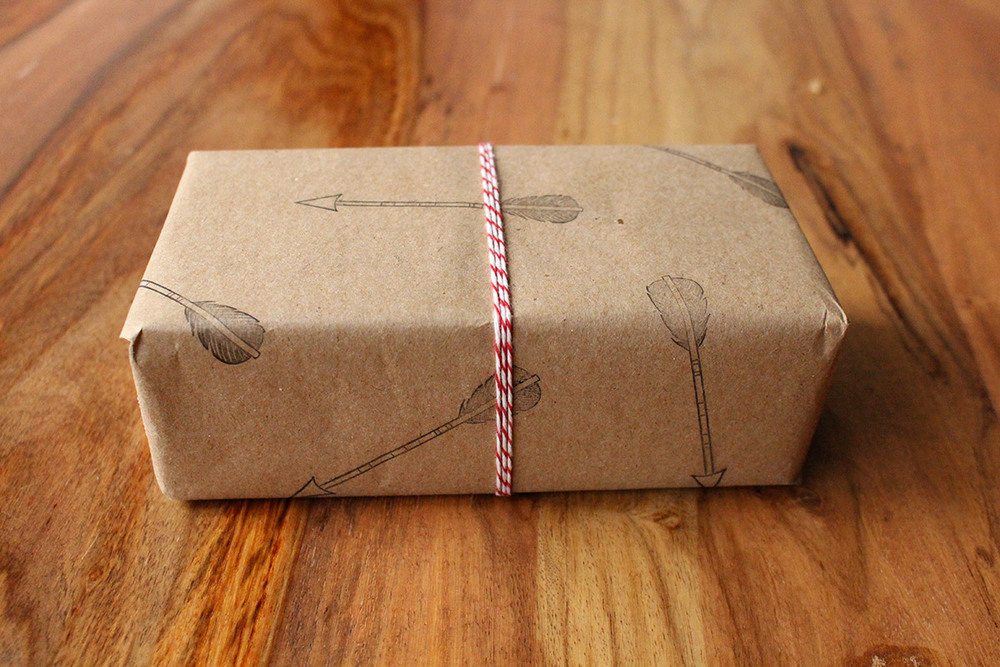 Simply Gifted:  Easy gift wrapping idea using brown paper, stamps and string!