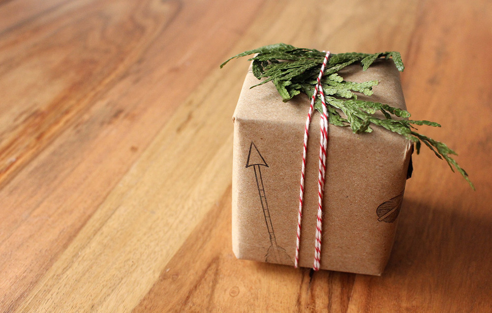Simply Gifted:  Easy gift wrapping idea using brown paper, stamps, string and fresh pine clippings.