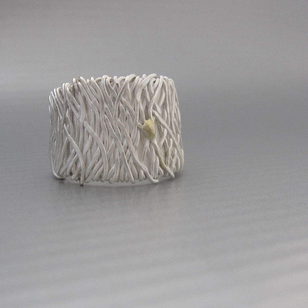 Reclaimed silver and 18k gold blend together to create this unique handmade band