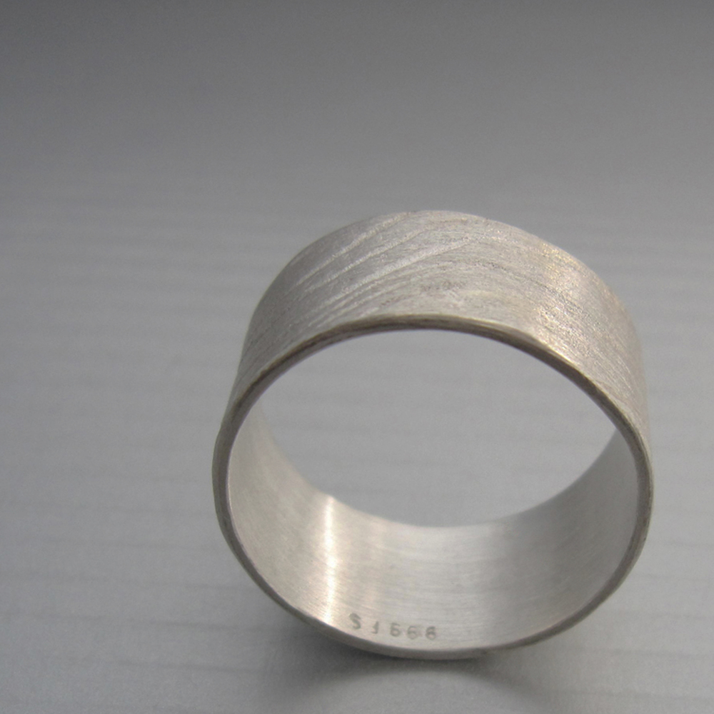 "in this image Maddalena Bearzi handmade ""onda"" ring clearly shows the stamp for fine silver (S999). At times, silver can still be real even without a stamp. Use the magnet test to check it."