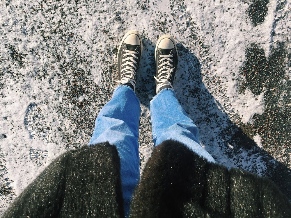 Vintage fake fur, jeans from & Other Stories and Converse.