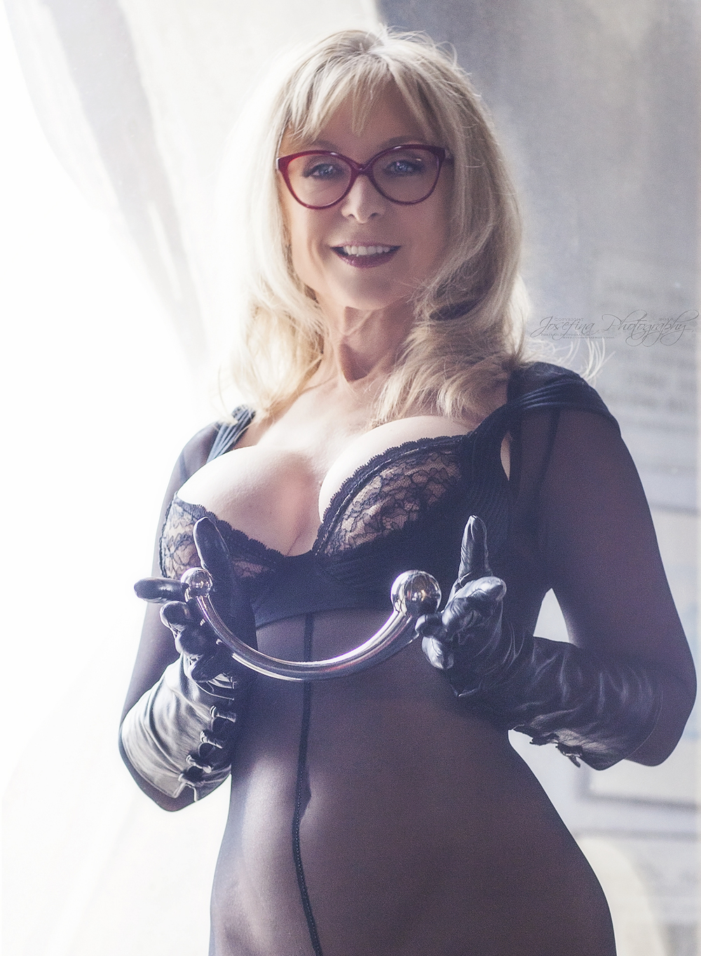 M: Nina Hartley | Glasses: Cutler & Gross | Bodysuit: WinterFetish.com | Bra: Wolford Fashion | Gloves: Bergdorfs | Copyright © Josefina Photography 2016