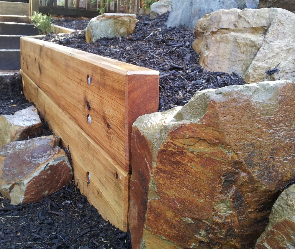 Dressed Cypress retaining wall
