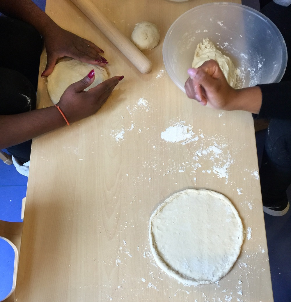 making and shaping pizza dough