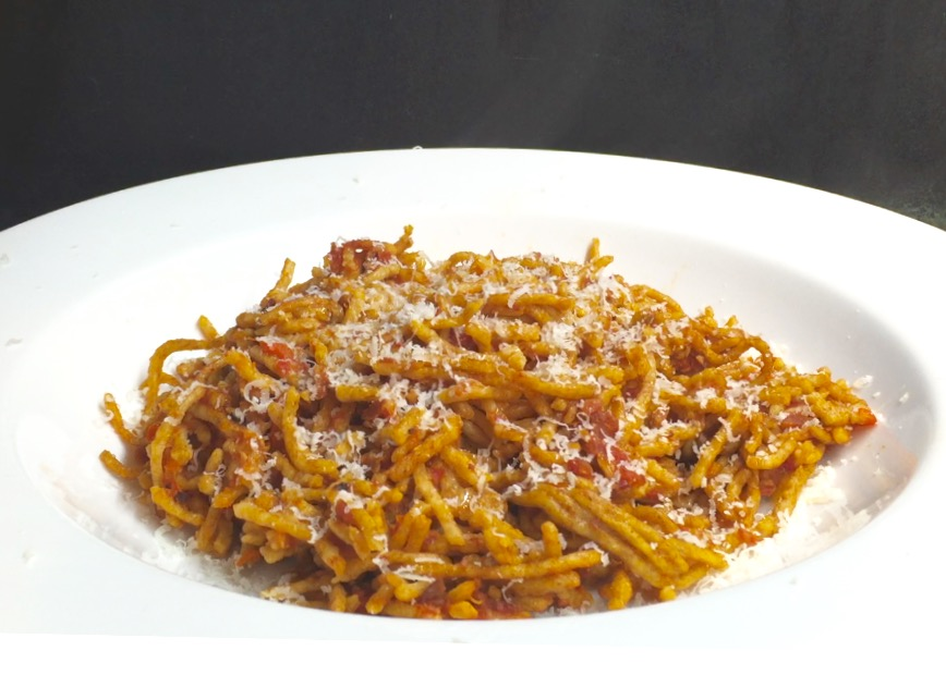 Handmade spelt spaghetti with tomato and bacon sauce