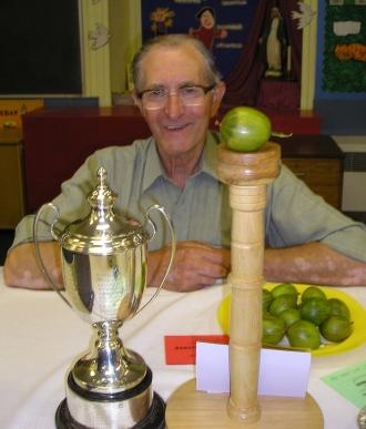 Bryan Nellist of the  Egton Bridge Gooseberry Society  with his world record heaviest gooseberry won in 2009, weighing in at 35 drams or roughly 62 grams.