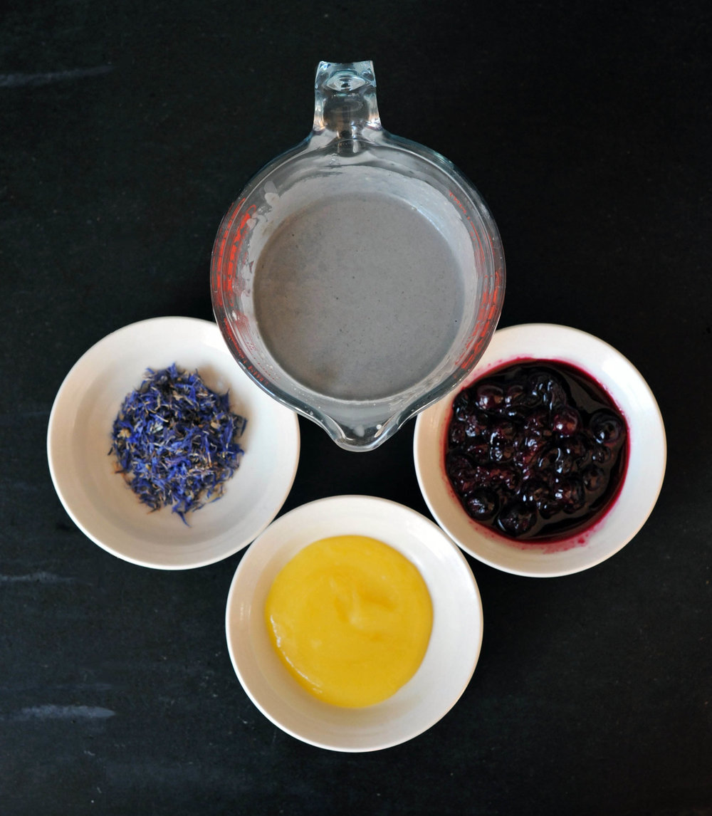 Charcoal pancake batter, dried cornflowers, lemon curd and blueberry compote -  Smy Goodness