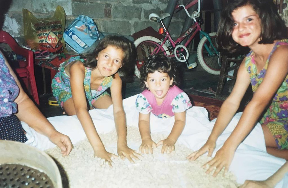 Aristea, her sister and cousin making trahanas with their Grandma