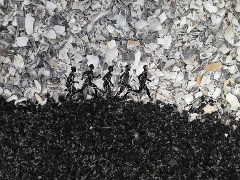 Shredded Rubber Runners in shell landscape.