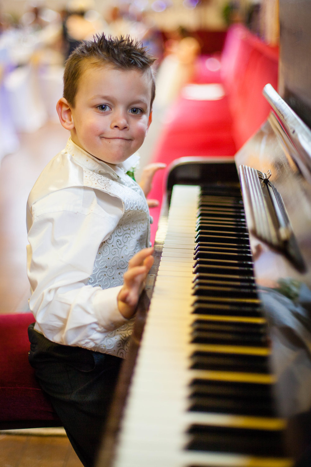 Young Page Boy plays the piano