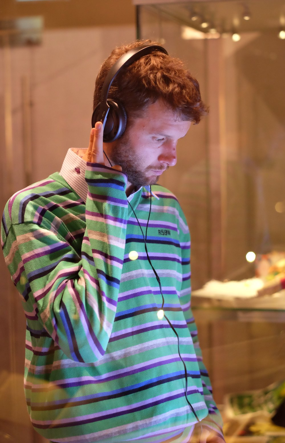Visitor listens to exhibition recordings
