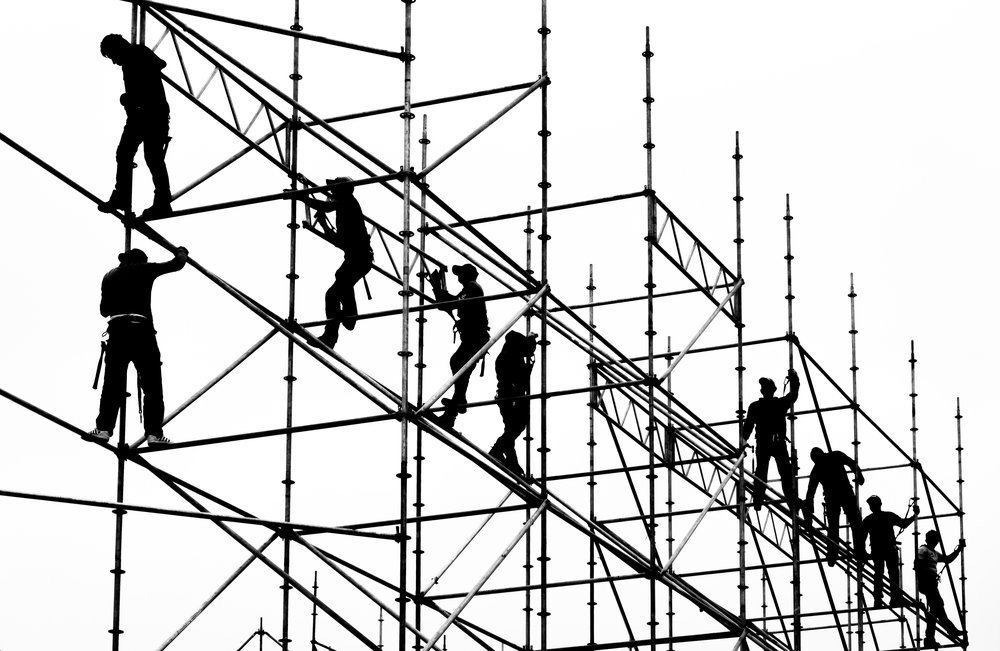 Scaffolders in front of Mexico City's Metropolitan Cathedral, Zocalo, Mexico City