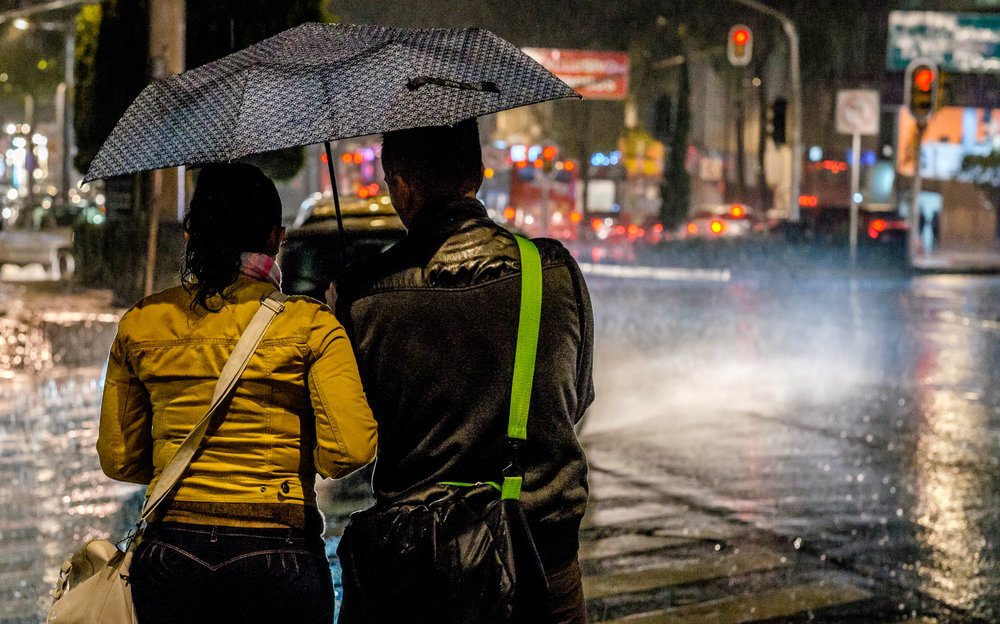 Couple in a rainstorm, Mexico City