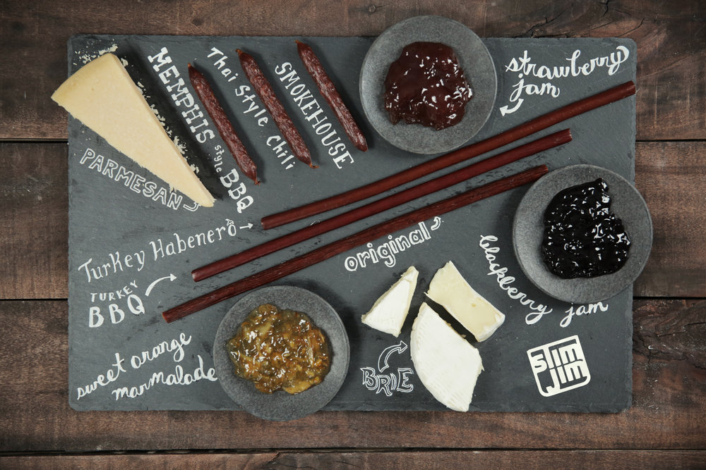 """When @hseanbrock referred to Slim Jims as """"hillbilly charcuterie"""", Slim Jim sent a hand-done charcuterie board, perfect for hosting fancy meat stick affairs."""