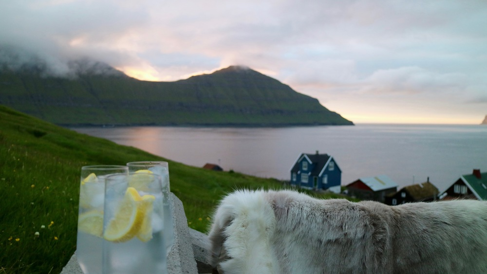 Testing the quality of gin and tonic on our back porch in our village Elduvík on Eysturoy