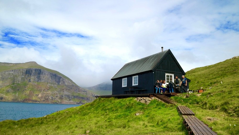 Check out mykines.fo. There might be a guided tour available, depending on the season