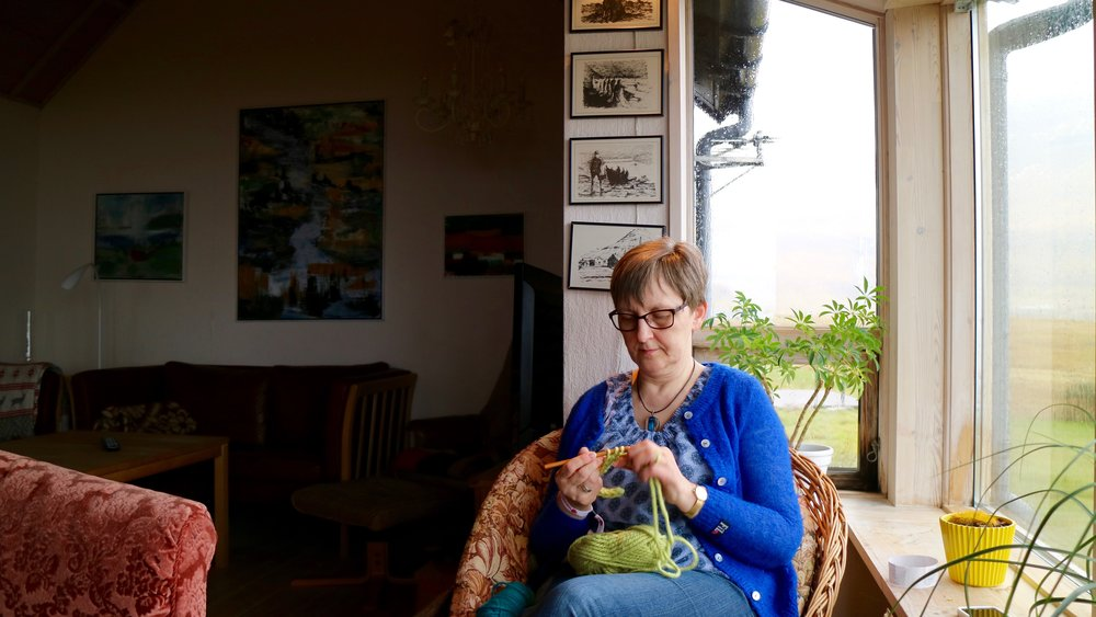 Hosting guests from the Knitting Festival at her home in Hellurnar: Jórun Eið Johannesen