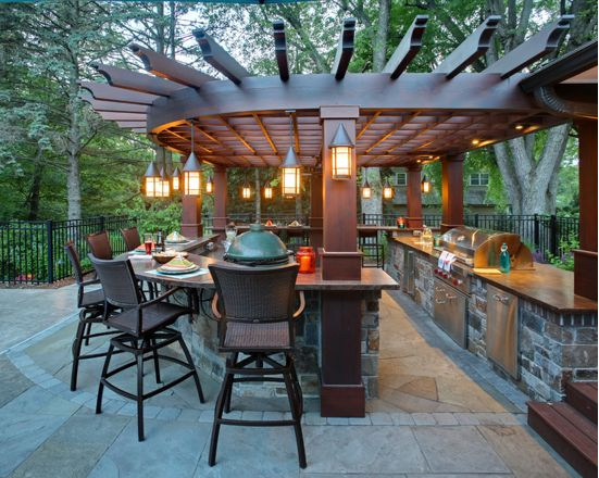 Pergola - Inspiration for a transitional backyard stone patio kitchen remodel in Minneapolis.