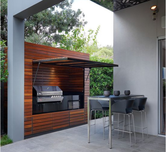 Storage - Large trendy backyard tile patio kitchen in Melbourne with a roof extension. Great idea for storage to protect grill from weather.