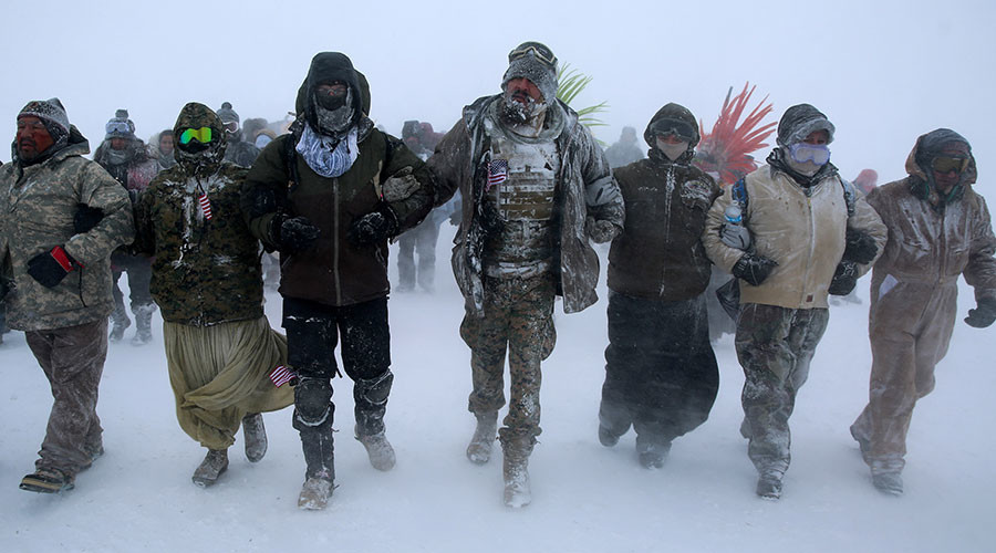 Army veterans forming human shield to protect NoDAPL protesters at Standing Rock, North Dakota, 2016.