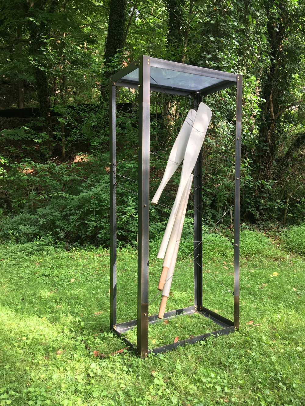 Unrecovered, unreturned   2018, Steel, brass, aluminum, polycarbonate, steel cable, sprayable rubber, wooden oars