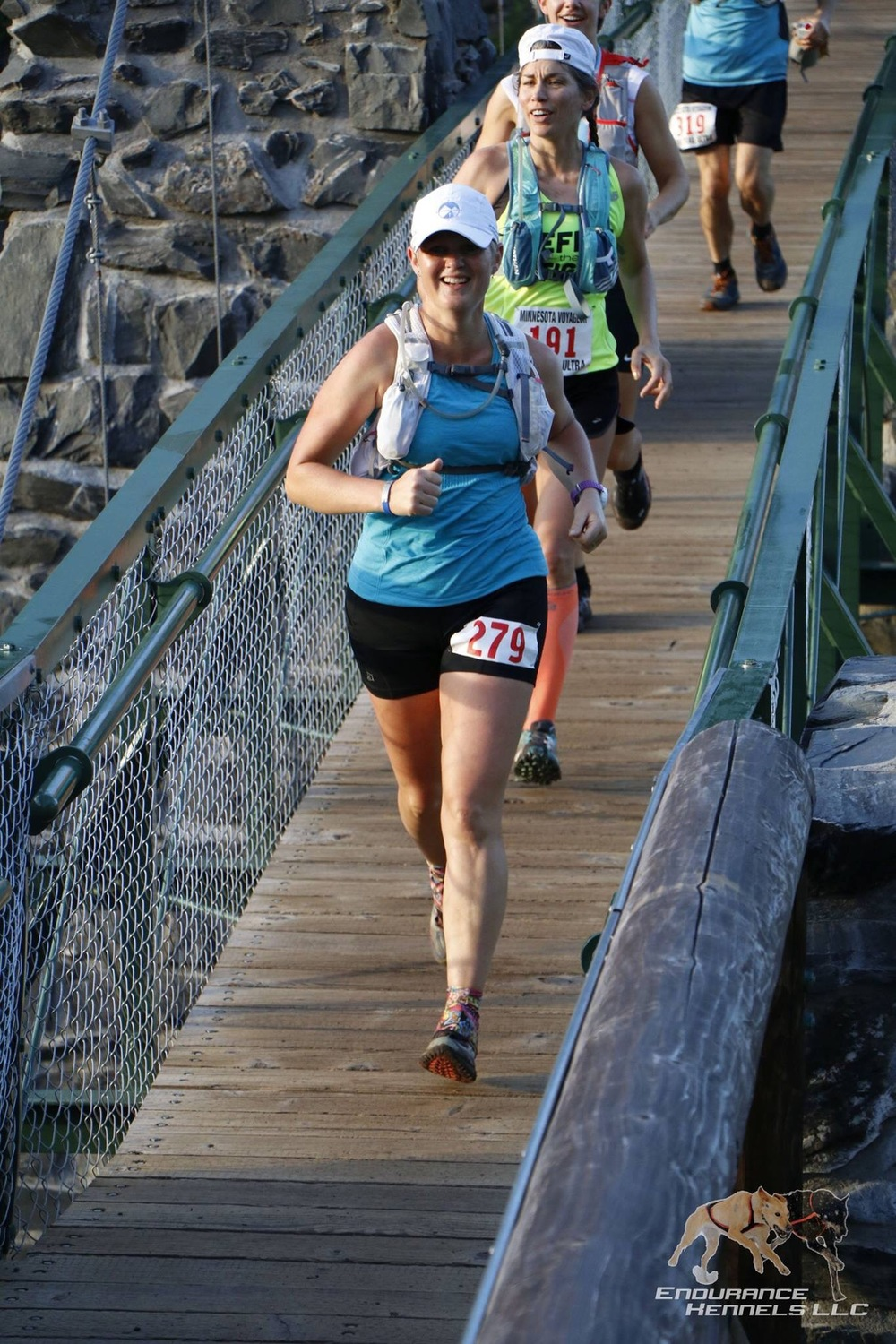 Crossing the swinging bridge 3+ miles in.  Endurance Kennels photo.