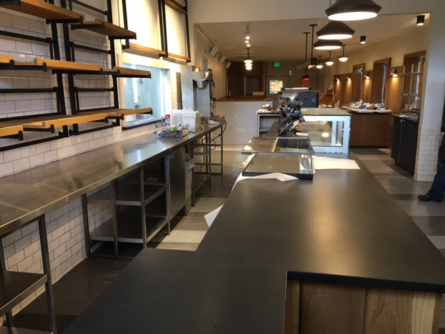 Behind the counter, which is now more streamlined with an additional register.